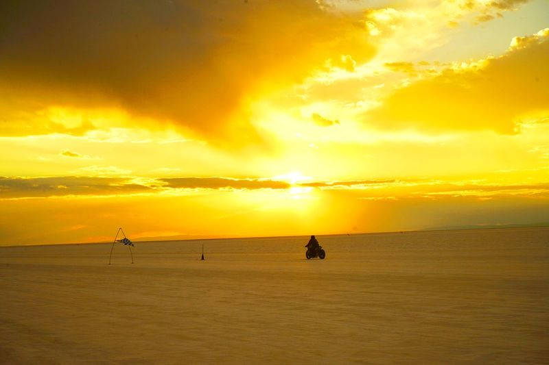 Bonneville Salt Flats USA Utah Beauty In Nature Cloud - Sky Landspeedracing Landspeedrecord Magicallight Nature Orange Color Outdoors Scenics Silhouette Sky Sun Sunrise Tranquil Scene Tranquility Yellow