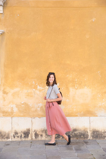 Long Skirt Travel Clothing Dress Fashion Full Length Happiness Italy One Person Portrait Real People Smiling Style Venice Walking Women Young Adult