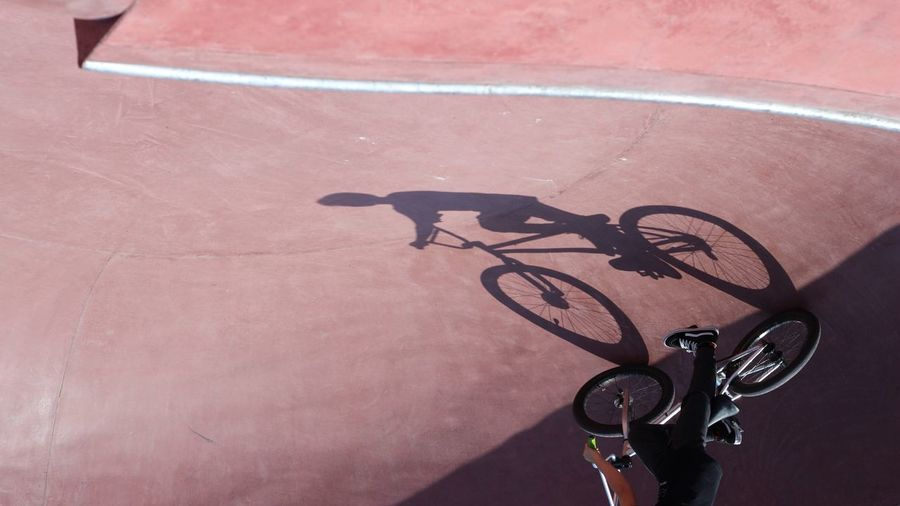 Low section of man cycling on sports ramp