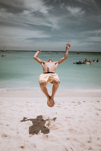 Aruba Beach Sea Water Land Sky Sand Cloud - Sky One Person Nature Human Arm Young Adult Full Length Real People Leisure Activity Horizon Over Water Adult Arms Raised Trip Body Part The Traveler - 2018 EyeEm Awards The Traveler - 2018 EyeEm Awards