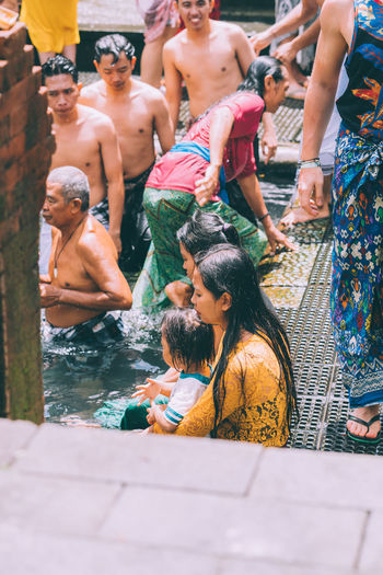 Bali INDONESIA Bali Temple Temple Water Temple Religious Festival Hindu Hinduism Real People Lifestyles Men Group Of People Women Leisure Activity People Adult Crowd Day Water Togetherness Childhood High Angle View Shirtless Enjoyment Females Pool Swimming Pool Outdoors