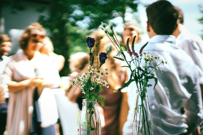 Flowers and people Real People Celebration Lifestyles Leisure Activity Women Men Outdoors Day Plant Flower Nature People Unrecognizable Person Blurred Motion Wedding Wedding Photography Weddings Around The World Party Vase Vase Of Flowers Flower Vase Socializing Social Gathering People Talking Marriage