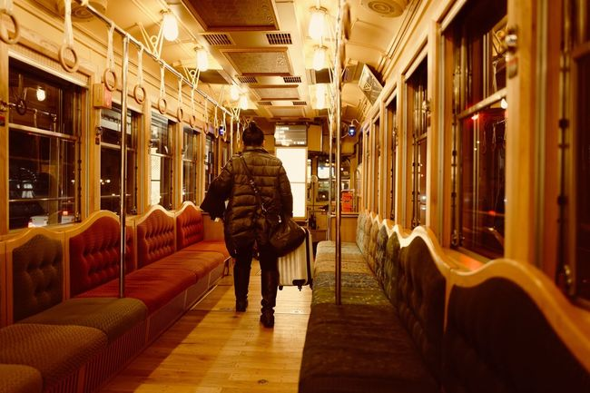 Night tram 🚋 310 MINATO Design is Eiji Mitooka ( 水戸岡鋭治 ) / LEICA Q 28mm No Filter No Flash Handheld de Good Night 310 MINATO Manual Mode Photography Snapshot Interior Design Wooden Texture Trainspotting Softness Sitting Around 水戸岡デザイン 水戸岡鋭治 Nagasaki Electric Tramway ( 長崎電気軌道 ) Public Transportation Transportation Mode Of Transport Real People Indoors  Illuminated