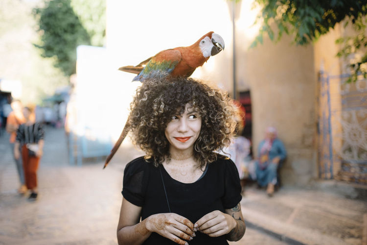 Bird Curly Hair Day Focus On Foreground Front View Hairstyle Nature One Animal Outdoors Parrot Portrait Waist Up Women