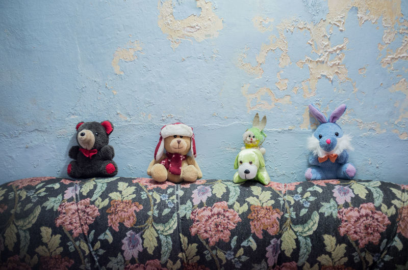 Toys on display on a couch in a flat in Vedado, Havana. Paint peeling from the walls. Cuba No People Peeling Paint Stuffed Toy Tourism Toy Toys Travel Travel Destinations