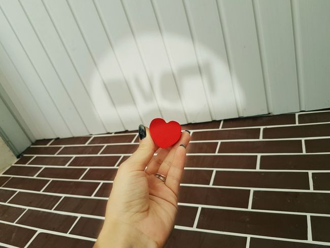 Human Hand Personal Perspective Red Shadows & Lights Shadow On The Seiling Shadow On The Wall Reflection Love The Word Love Letters Red Heart Heart Shape Mix Yourself A Good Time The Week On EyeEm EyeEmNewHere Lifestyle Hands Up Brick Wall