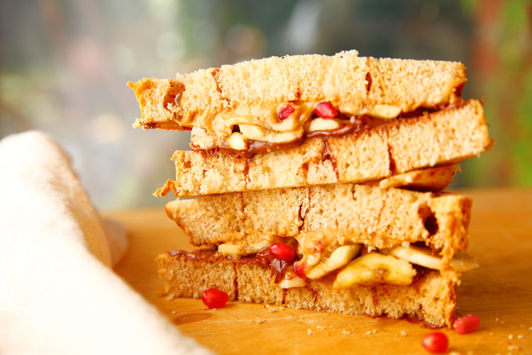 Stacked peanut butter sandwich Homemade Food Lunch Natural Light Snack Textures Bananas Breakfast Cinnamon Swirl Bread Close-up Delicious Fabric Food Light Meal Napkin No People Peanut Butter Sandwich Pomegranate Seeds Ready-to-eat Sandwich Stack Studio Shot Sweet Food Tasty Temptation