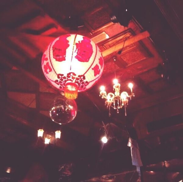 at white trash. combination of a mirrorball, a chinese lantern, and a chandelier.