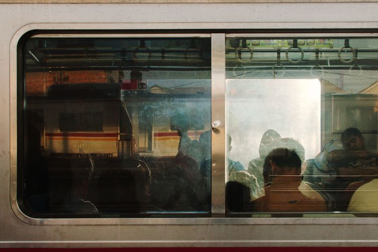A scene from Depok Train Station, Indonesia. December 2017 Streetphotography Documentaryphotography Train Commuter Commuting Commuter Train Commuters Commuterline Morning Morning Light Local Transport City Transportation UNPOSED Candid Window Train - Vehicle Public Transportation Transportation Built Structure Looking Through Window Day City EyeEm Ready   The Street Photographer - 2018 EyeEm Awards