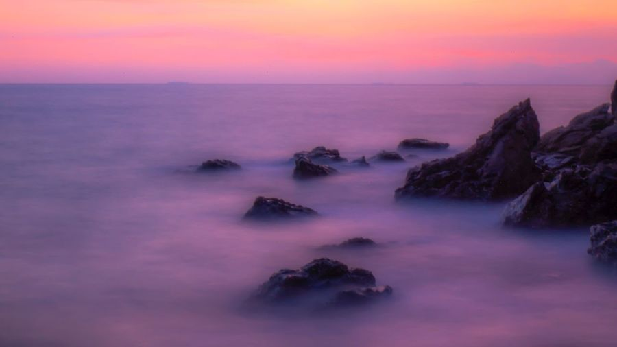 Long exposure of wave in the sea Sunset Smooth Sea Sky Beauty In Nature Scenics - Nature Water Sunset Solid Tranquil Scene Rock Tranquility Rock - Object Horizon Over Water Horizon Idyllic Purple Nature Long Exposure Land No People Outdoors