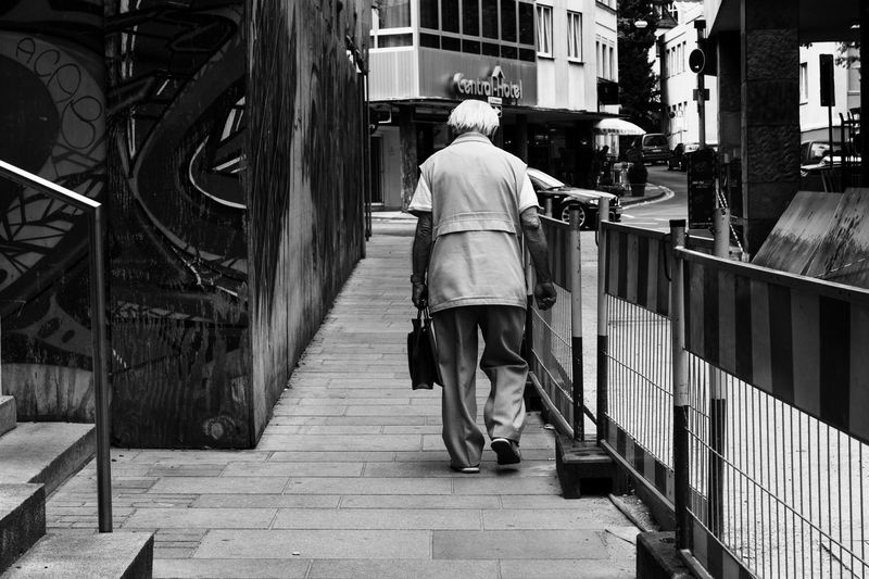 Architecture Black & White Black And White Blackandwhite Building Built Structure Casual Clothing City City City Life Day Full Length Leisure Activity Lifestyles Man Old Outdoors Street Street Photography Streetphoto_bw Streetphotography The Way Forward Town Urban Walkway