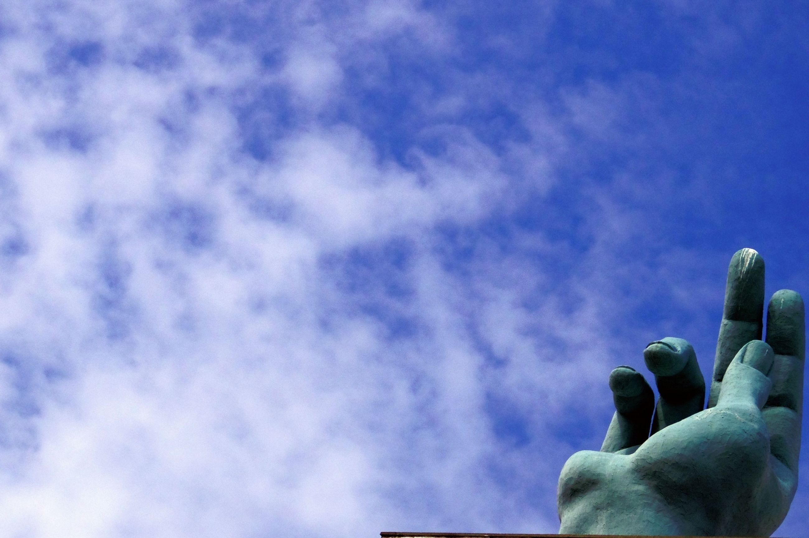 low angle view, sky, blue, cloud - sky, cloud, animal themes, human representation, nature, statue, sculpture, cloudy, outdoors, silhouette, beauty in nature, day, no people, wildlife, animals in the wild, tranquility