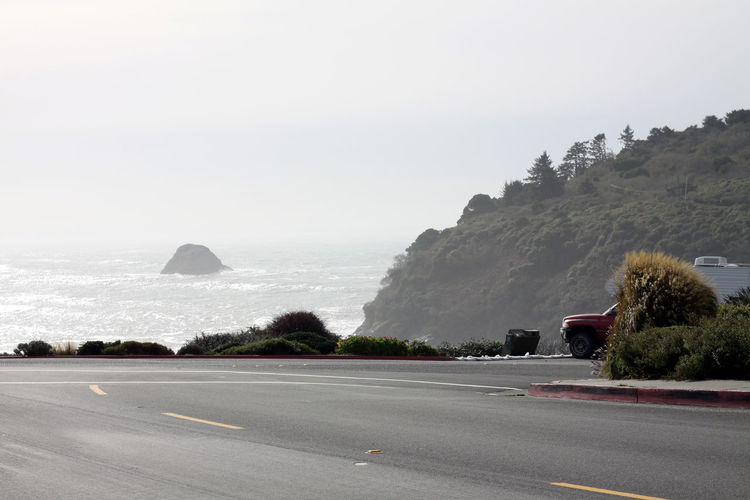Loneliness California Car Day Fog Foggy Hill Landscape No People Ocean Outdoors Street Tree