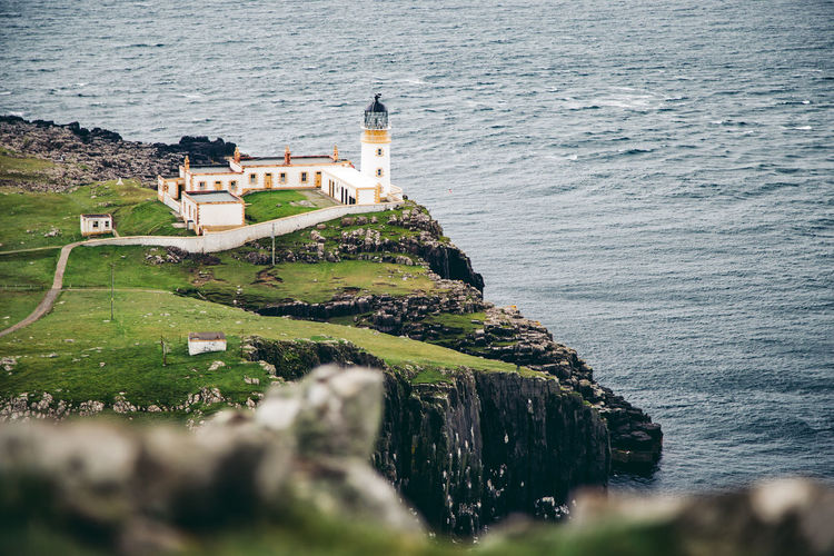 A beautiful of Neist Point Lighthouse Coastline Lighthouse Rain Scotland Cliff Day Famous Place Fog Island Isle Of Skye Nature Neist Point Lighthouse No People No People, North Outdoors Rock - Object Sea Seascape Uk Water