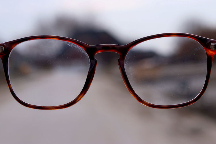Close-up of eyeglasses outdoors