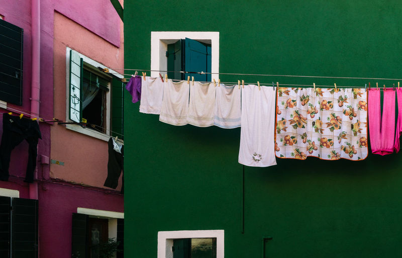 Clothes drying on clothesline in burano, venice, italy
