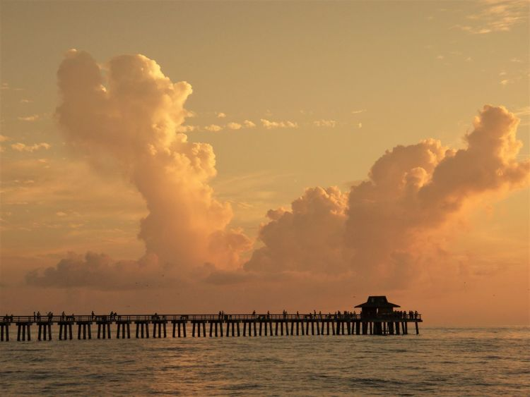 orange clouds at the pier of naples, florida Architecture Beach Calm Cloud - Sky Day Evening Fishing Area Florida Gloaming High Clouds Landscape Naples Nature Ocean Orange Clouds Outdoors Pier Scenics Sea Sky Sunset Tranquil Scene Tranquility USA Water Miles Away