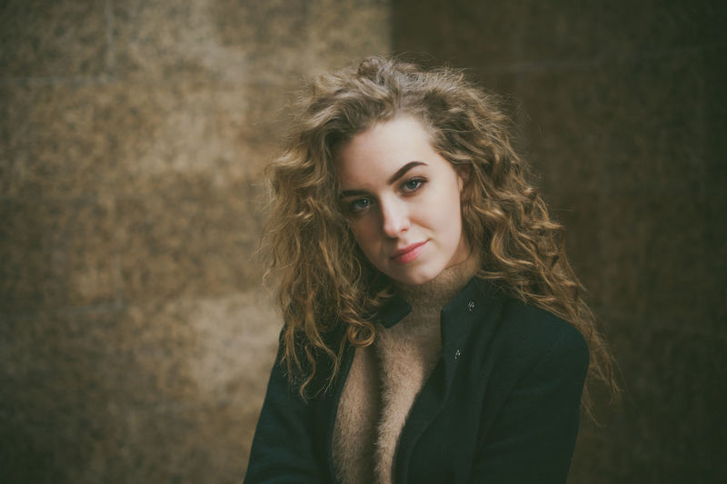 Beautiful Woman Beauty Brown Hair Contemplation Front View Hair Hairstyle Headshot Indoors  Long Hair Looking At Camera One Person Portrait Real People Standing Teenager Wall - Building Feature Women Young Adult Young Women