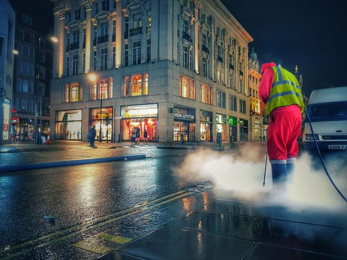 interesting things happen when the city is asleep London Londonatnight Night Nightphotography Cleaner Cleaning Streetphotography Streets A Man Cleaning A Street In London Nightime City LONDON❤ Wetatnight Wetstreet Smoke Gas Rain Building Exterior Architecture Night Wet Built Structure City City Life Water Sky Occupation People