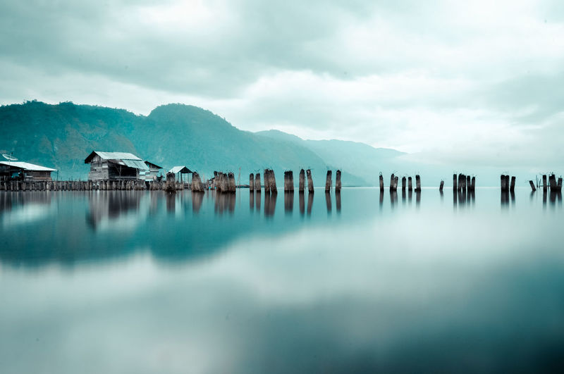 heaven in indonesia Water Mountain Sky Cloud - Sky Scenics - Nature Reflection Tranquility Lake Tranquil Scene Mountain Range No People Travel Destinations Beauty In Nature Nature Architecture Wooden Post Day Built Structure Post Outdoors