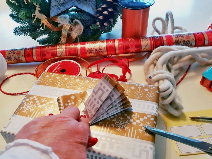 Wrapping Christmas Presents. ... Wrapping Paper Wrapping Wrapping Presents Decorating Ideas Decorating Presents Ribbon Scissors Folded Folded Paper Folding Ballpoint Pen Stickers Preparation For Christmas Preparation For Christmas Christmas Present Christmastime Christmas Preparations Human Hand Christmas Holding Close-up Christmas Decoration Christmas Ornament