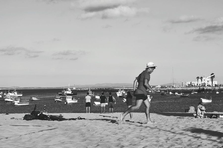 Beach summer fun Black & White Black And White Monochrome _ Collection Monochrome Beach People people and places Cascais Baía Cascais EyeEm Selects Water Beach Sea Full Length Sand Men Standing Sky Shore Beach Volleyball Horizon Over Water Hooded Beach Chair Calm Volleyball - Sport Ocean Sandy Beach