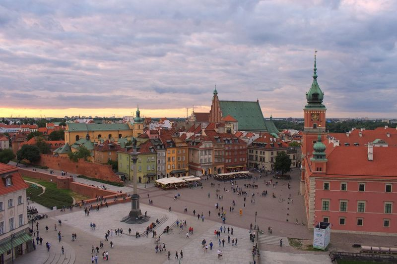 Castle Old Town Square Old Town Warsaw Poland Architecture Building Exterior Built Structure Sky City Cloud - Sky Crowd Building Travel Destinations Sunset Tourism Cityscape Tower High Angle View Travel Street