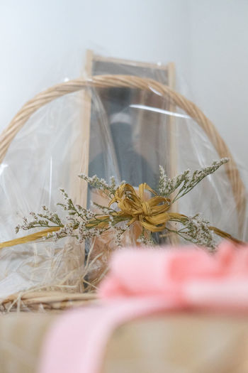 Close-up of basket wrapped in plastic