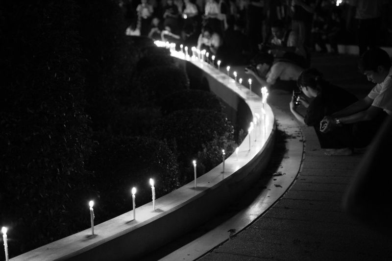 Sad Day Thailand Architecture Beauty In Nature Black And White Building Exterior Built Structure Candlelight Candlelighting Candlelights City Illuminated Large Group Of People Nature Night Outdoors People Real People Sadness Tree Water