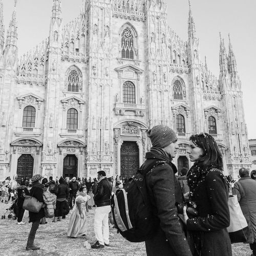 Tourists in front of building