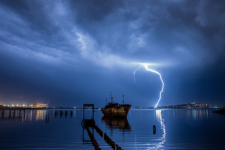 Lightning Forked Lightning Thunderstorm Water Power In Nature Sea Storm Cloud Blue Storm Sky Shore Dramatic Sky Beach Wave Horizon Over Water Atmospheric Mood Calm Ocean
