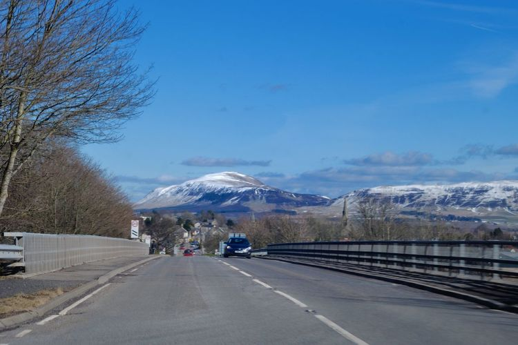 Driving Scotland Beauty In Nature Day Landscape Mountain Mountain Range Nature No People Outdoors Road Scenics Sky Snow Snowcapped Mountain The Way Forward Transportation Tree Winter