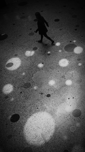 High angle view of silhouette man walking on street