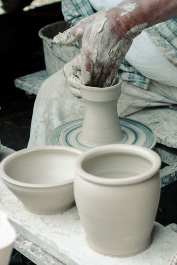 Adult Art And Craft Clay Clay Pot Clay Work Claypot Close-up Creativity Day Earthenware Human Body Part Human Hand Indoors  Making Motion Mud One Person People Pottery Real People Skill  Spinning Wet Working Modern Workplace Culture Small Business Heroes