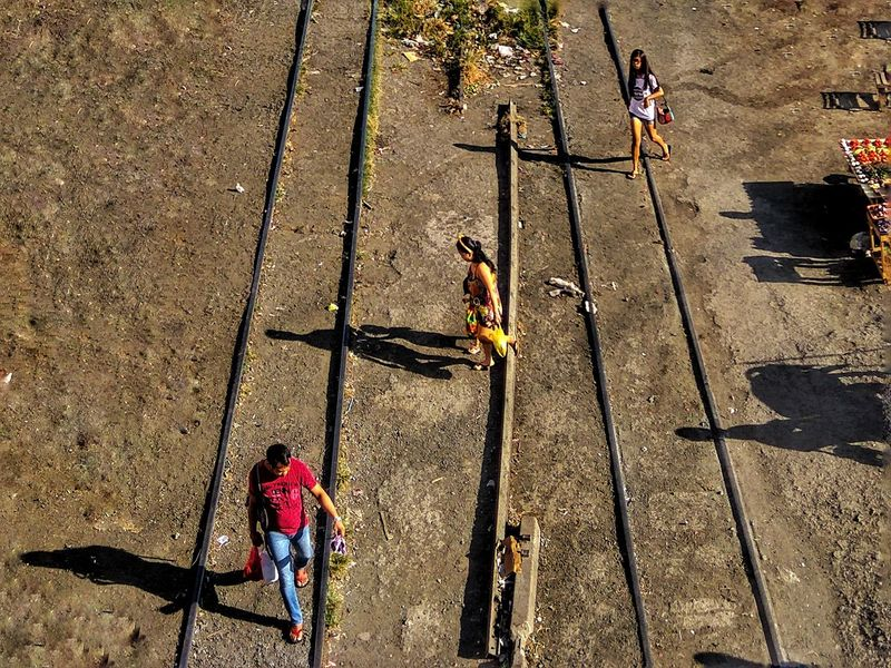 Mobile Photography Street Photography Eyeem Philippines Kulotitay Clicks High Angle View Railway Track Shadows & Lights Track Train Afternoon Walk Mobileglobalshooters Outdoors Walking Three People Diagonal From My Point Of View Flying High The Street Photographer - 2017 EyeEm Awards