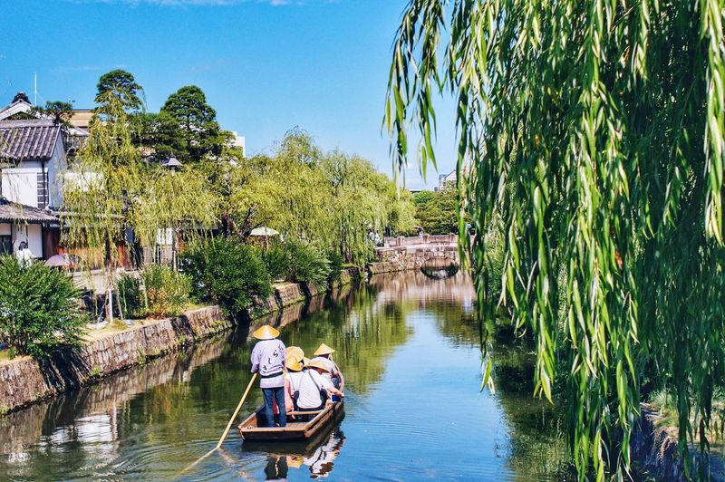 People on japanese gondola in canal