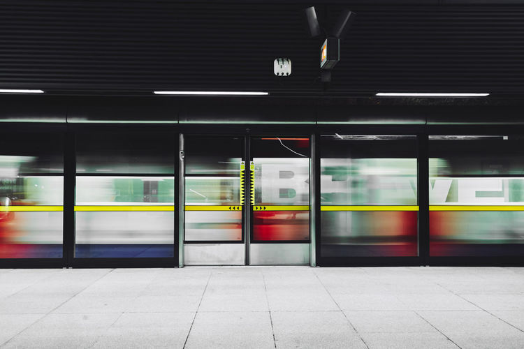 Blurred motion of train moving at railroad station platform