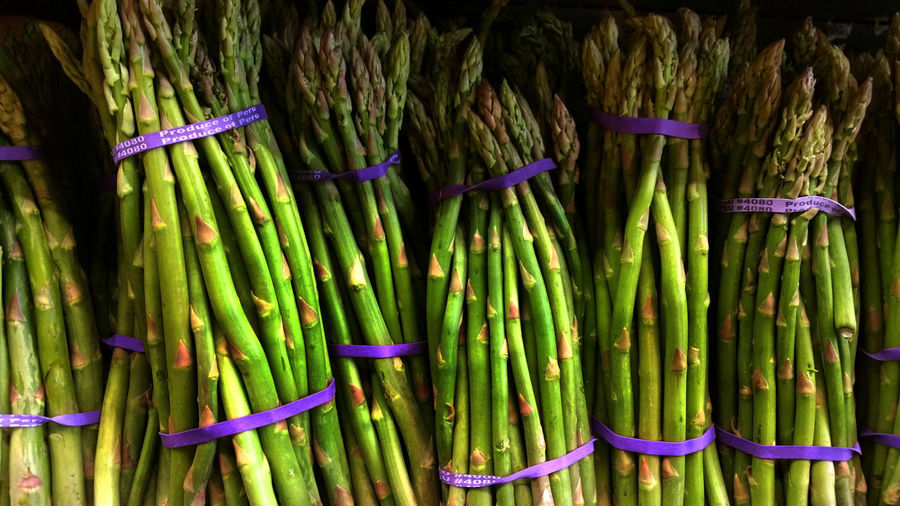 Close-up of fresh organic green asparagus bunches