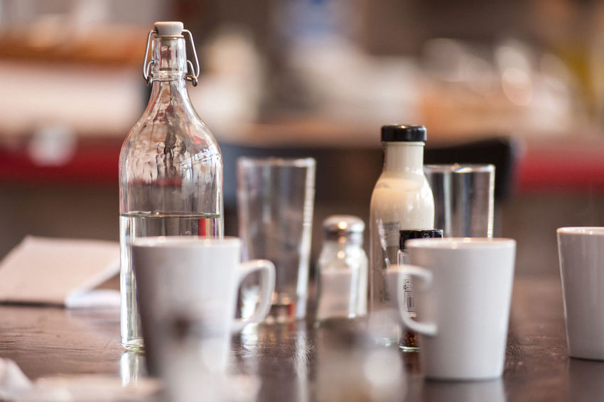 Cafe scene Bottle Cafe Close-up Day Drink Drinking Glass Focus On Foreground Food And Drink Freshness Indoors  No People Refreshment Table Tabletop