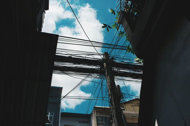 The city of Cambodia. Cable Electricity  Power Line  Connection Low Angle View Power Supply Electricity Pylon City Getting Inspired Urban Street Photography Urban Geometry Urban Photography Urban Exploration The City Telephone Line Technology Street Photography Look Up View Look Up Look Up And Enjoy The View Cambodia Phnom Pehn, Cambodia