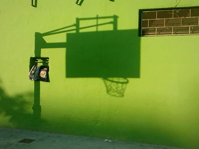 View of basketball hoop against wall