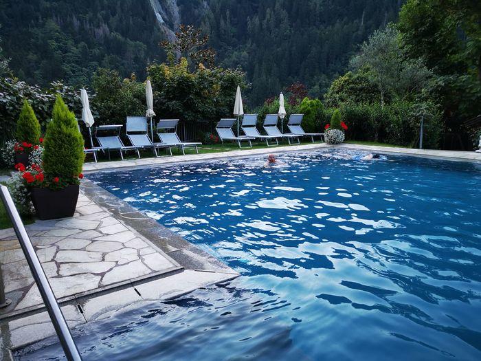View of swimming pool in yard