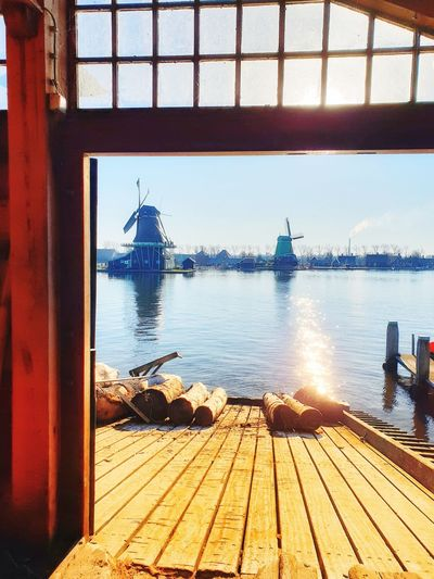 Pier Wooden Wind Mill Holland Netherlands Zaanse Schans Zaanseschans Zaandam Netherlands Windmills Water Nautical Vessel Sea Window Sailing Sunlight Sky Architecture Horizon Over Water Built Structure Sailboat Boat Deck Mast Boat Sailing Ship Shore Water Vehicle Outrigger