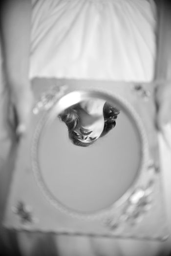 Midsection Of Woman Holding Mirror