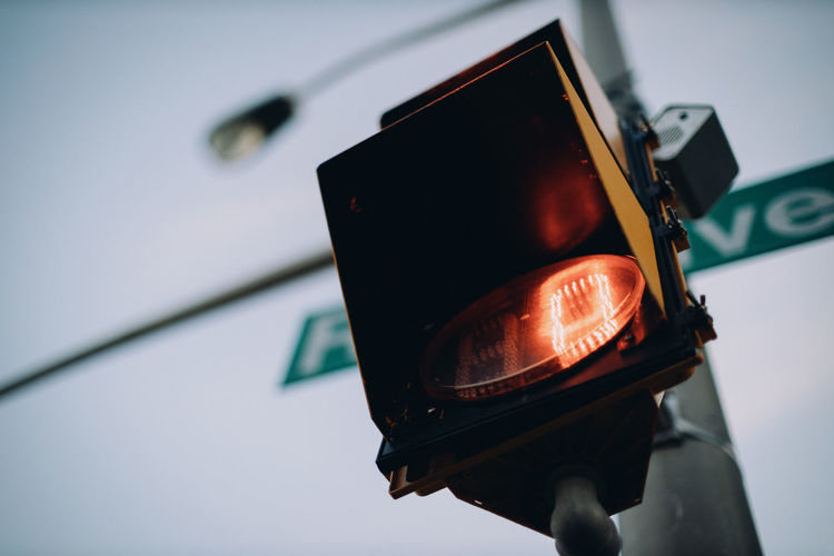 Looking up at traffic light timer.