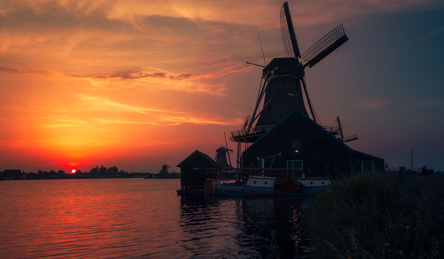 Remo SCarfo Dutch Windmills Amsterdam Sunset Sky Water Cloud - Sky Orange Color Environmental Conservation Renewable Energy Nature Alternative Energy Architecture Fuel And Power Generation Wind Power Traditional Windmill No People Beauty In Nature Wind Turbine Built Structure Environment Scenics - Nature Outdoors EyeEmNewHere