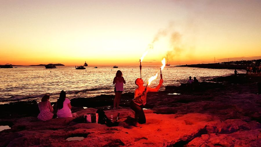 Fire sunset in San Antoni Ibiza Sunset Sea Water One Man Only Beach Horizon Over Water Nature Outdoors Night Heaven On Earth Joro Be Joro Colourful Best View Day Off Beautiful Sunset Tranquil Scene Cloud - Sky Amazing View Beauty In Nature Travel Destinations Amazing Place Ibiza Ibiza2017 Ibiza Sunset San Antonio Ibiza