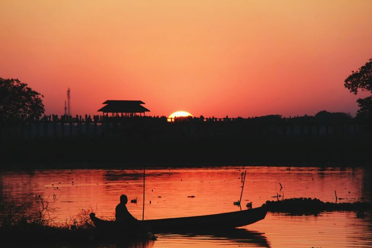 Water Sunset Architecture Sky Lake Reflection Nature Travel Destinations Environment Sun Travel Landscape Beauty In Nature Twilight People Building Exterior Tourism Tranquility Outdoors Arrival Mandalay