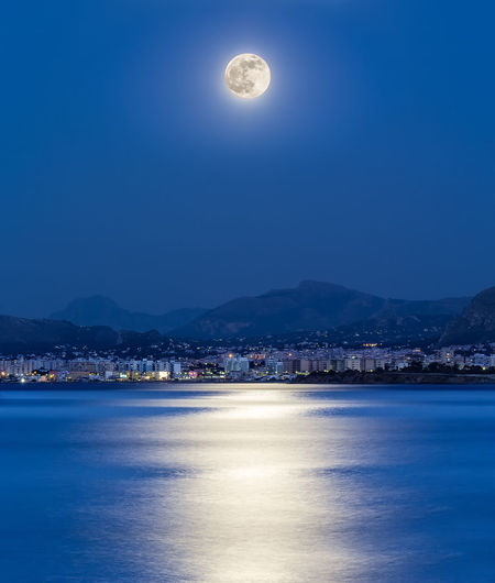 HUAWEI Photo Award: After Dark Palermo Bay Beauty In Nature Blue Full Moon Illuminated Italy Moon Moonlight Mountain Mountain Range Nature Night No People Outdoors Scenics - Nature Sea Sky Tranquil Scene Tranquility Water Waterfront