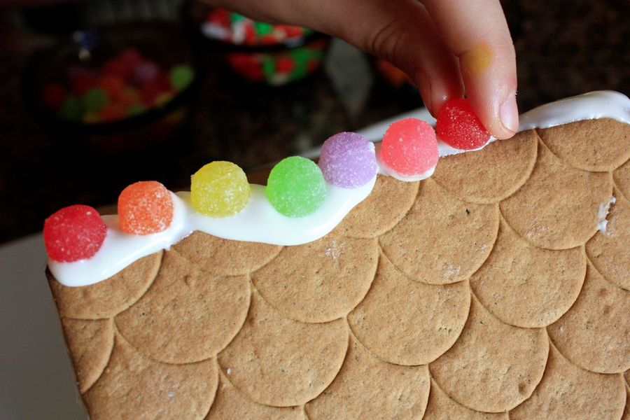 Christmas tradition: Gingerbread! Candy Christmas Decoration Gingerbread House Gumdrops Human Hand Icing Sweet Food Tradition